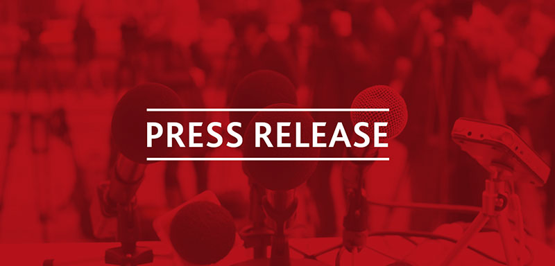 Image with microphones, cameras, people saturated with red overlay with the words 'Press Release'