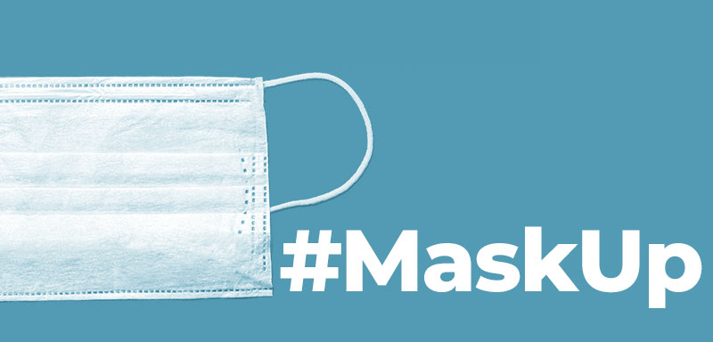 A mask with a blue background and the text #Maskup