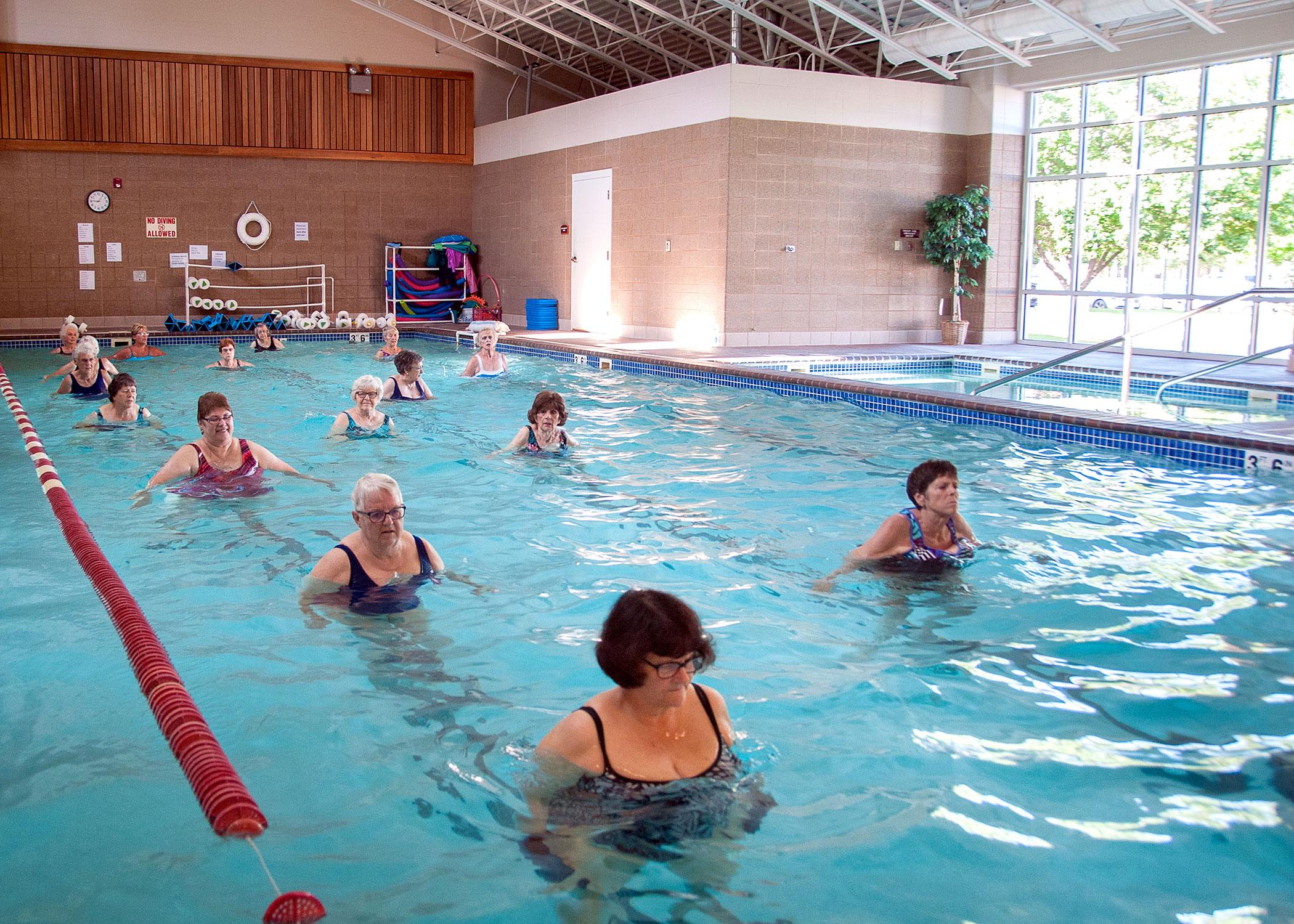 Group of female residents in the pool enjoying an aqua class