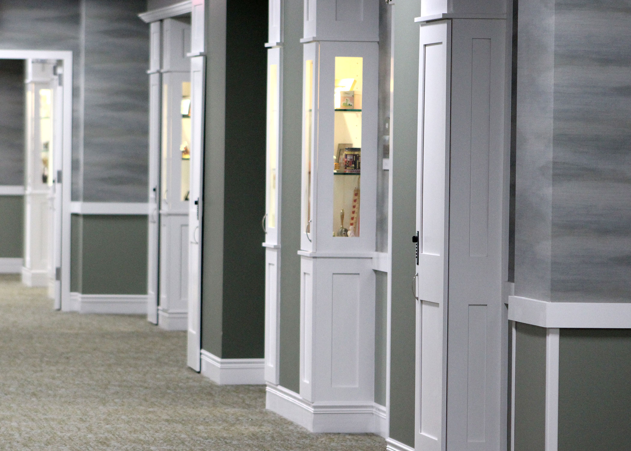 Hallway in Enhanced Assisted Living and Memory Care with a Personalize Entrance Hutch