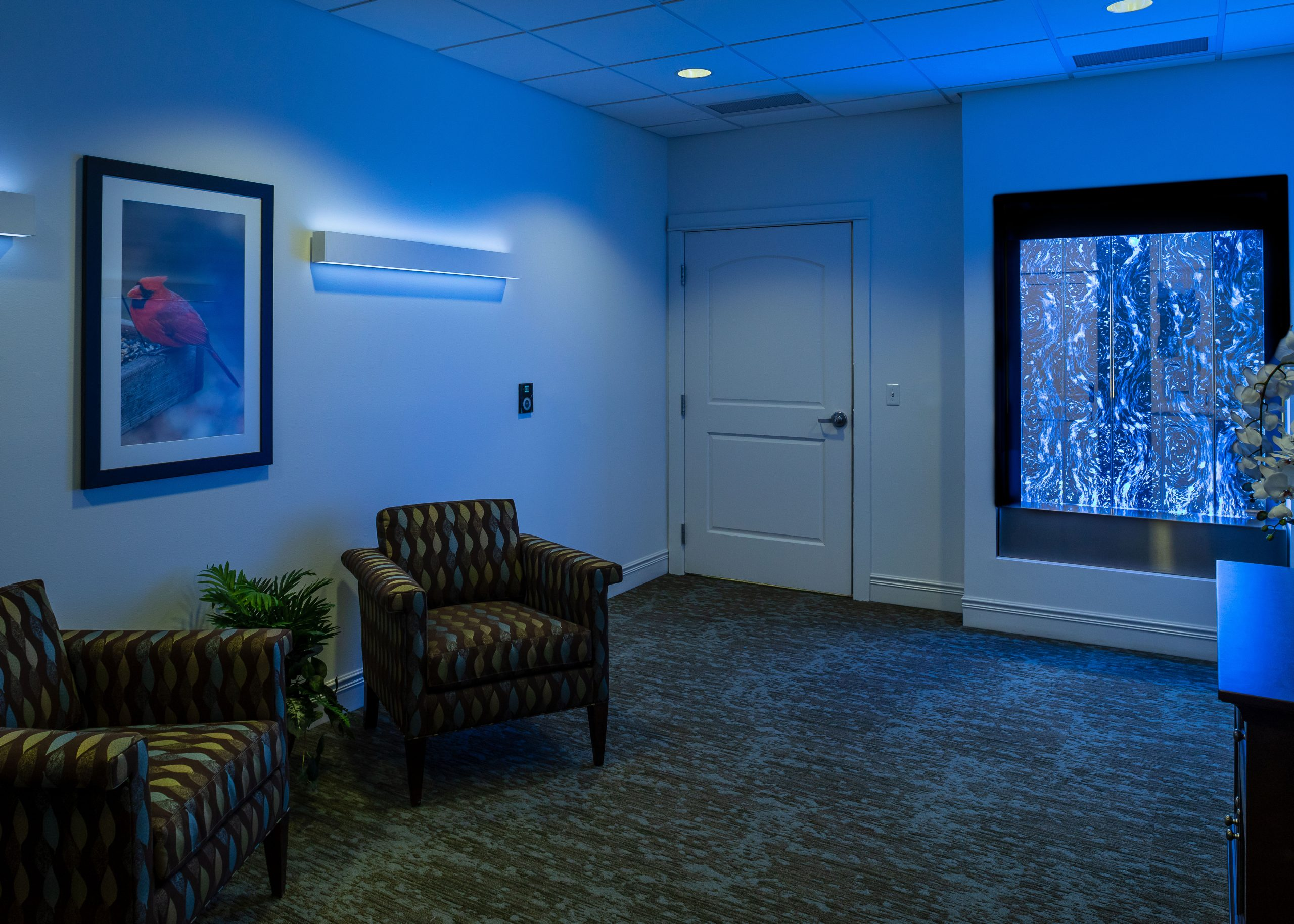 Enhanced Assisted Living and Memory Care with blue lighting, chairs and sensory wall