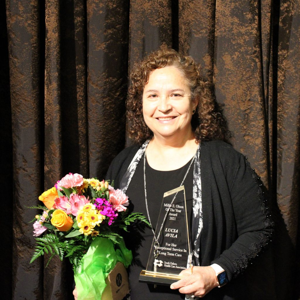 Lucia Avila with Millie E. Olson Award of the Year